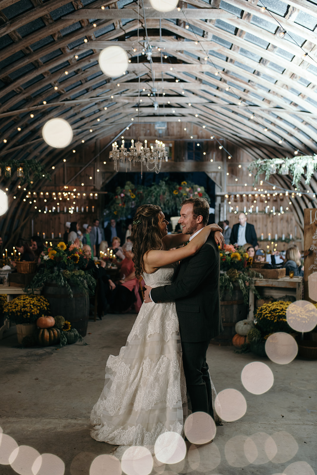 bride and groom first dance under twinkly lights the barn wedding venue