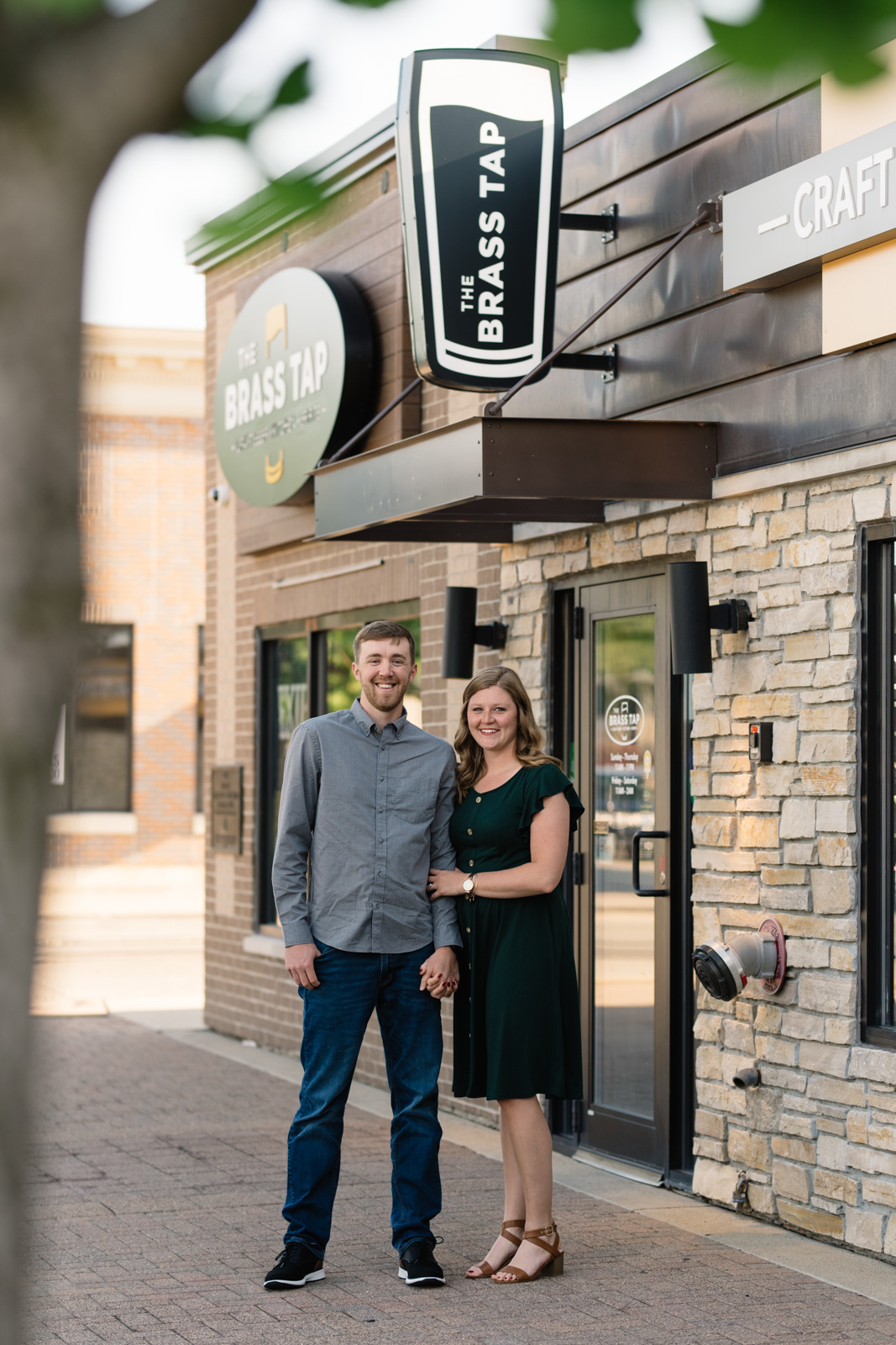 couple outside brass tap cedar falls engagement