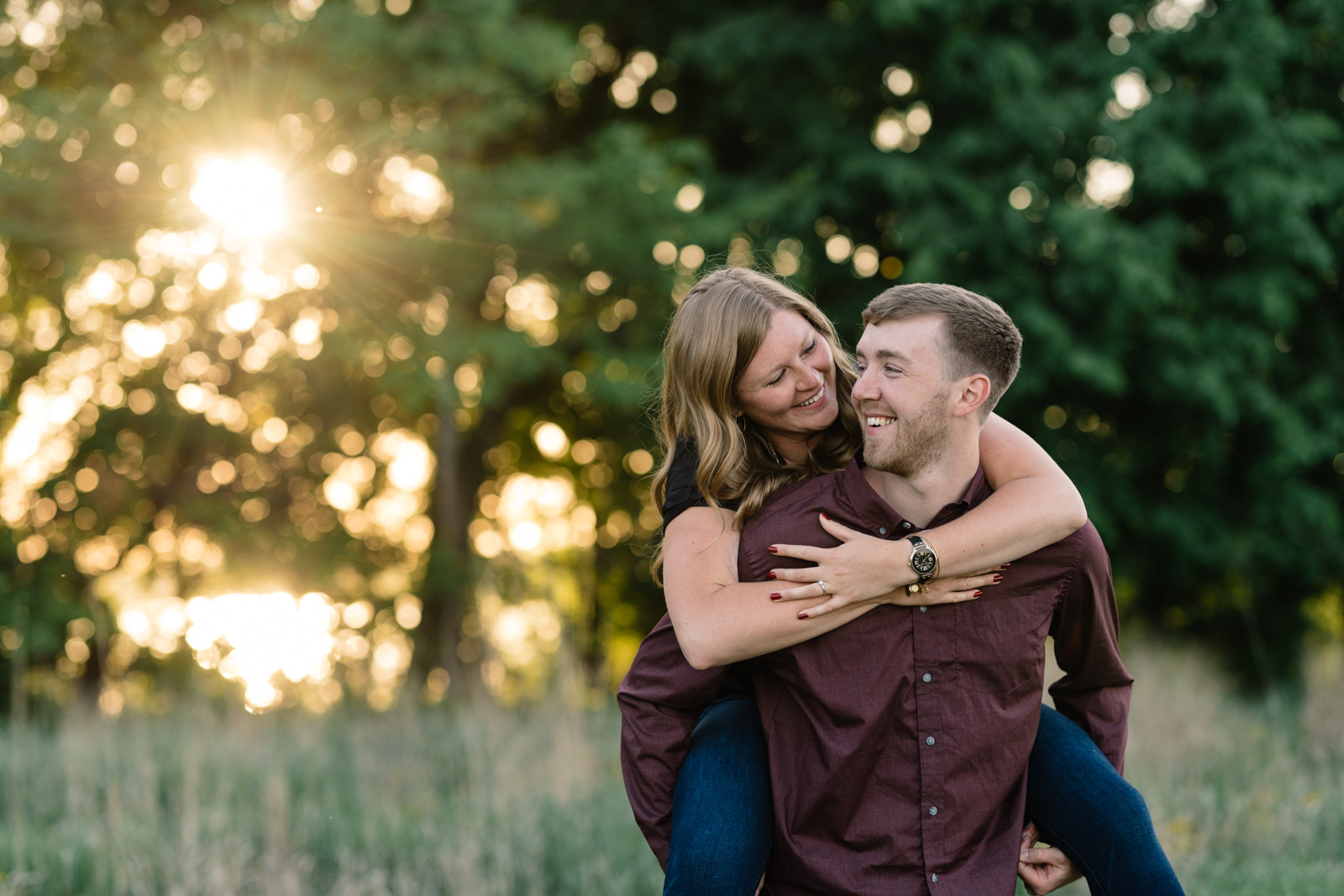 couple piggy back ride cedar falls june engagement