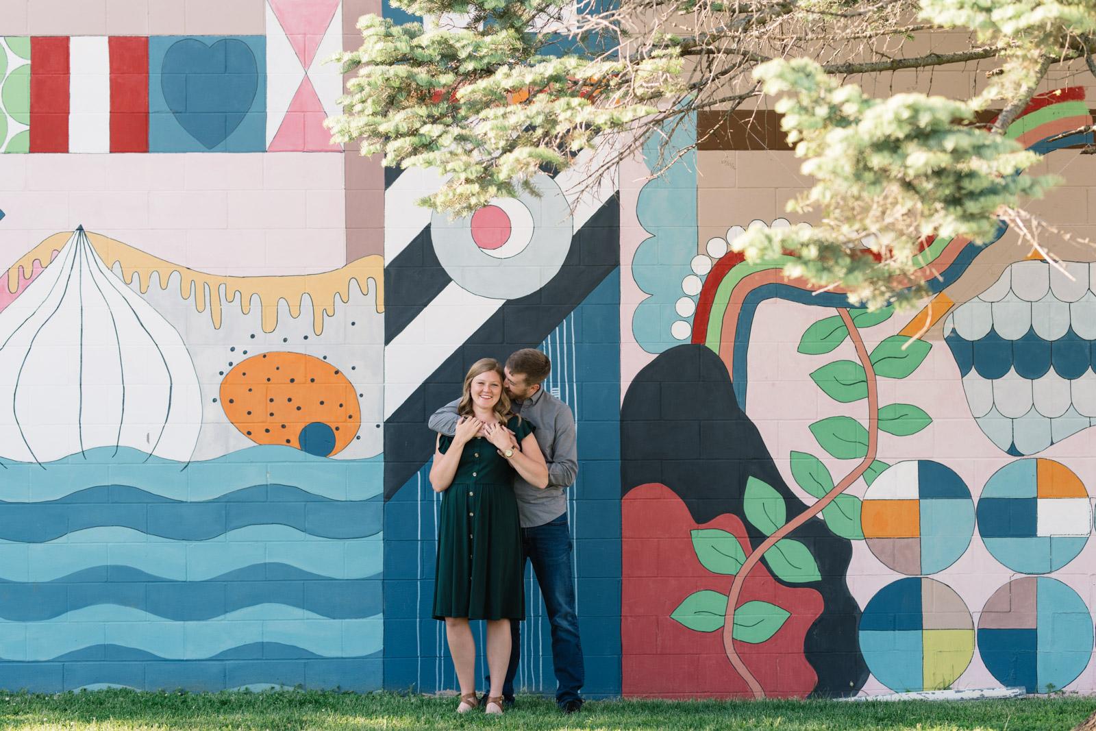 couple in front of mural cedar falls