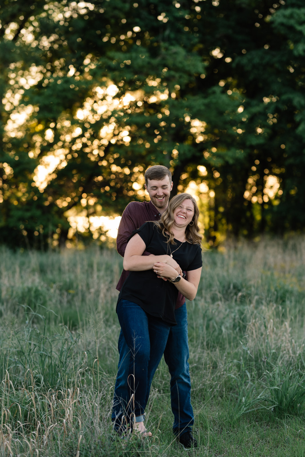 couple in field cedar falls June engagement session