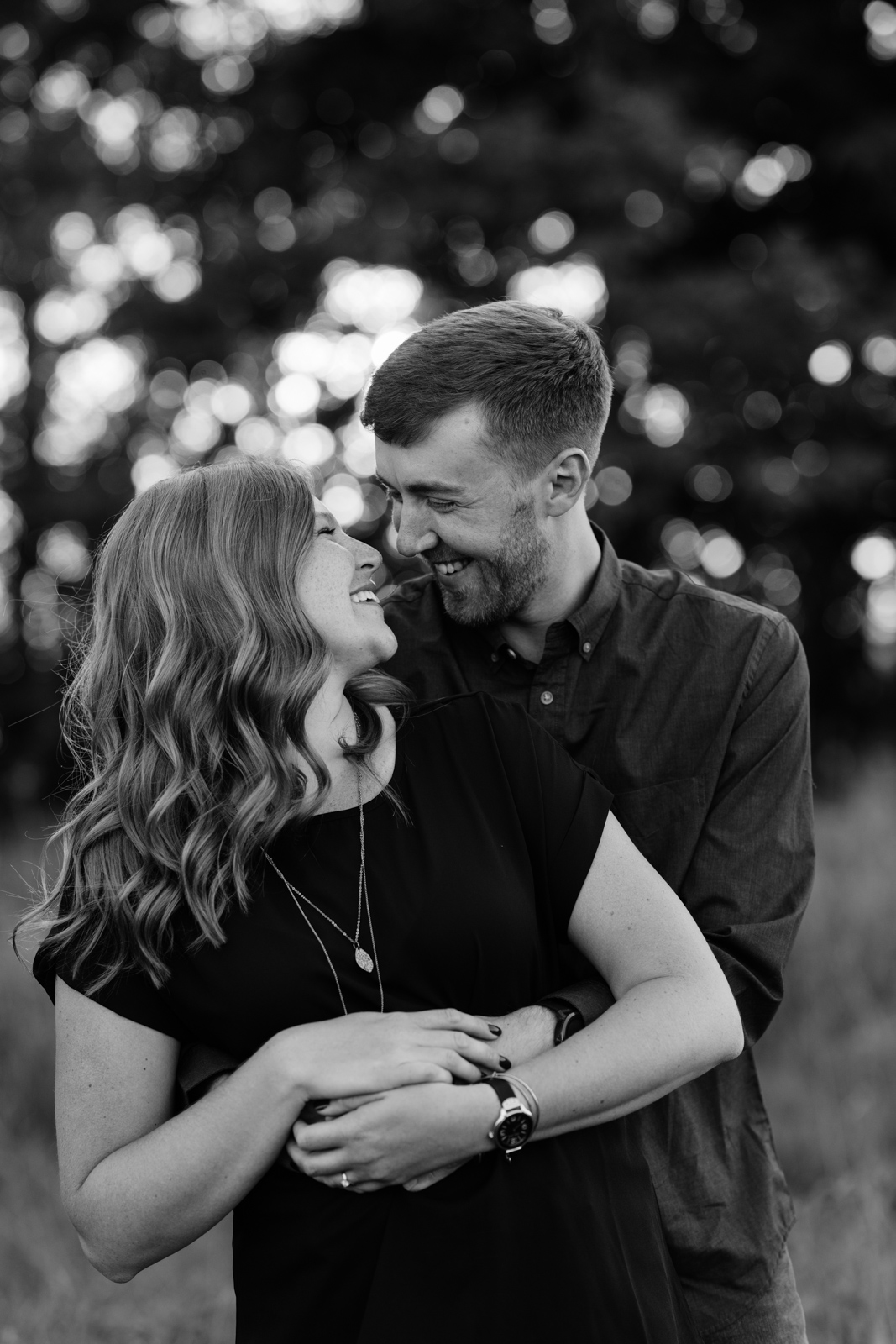 couple cuddling george wyth state park engagement session