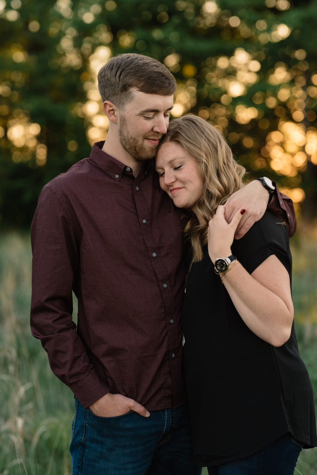couple cuddling cedar falls June sunset engagement session