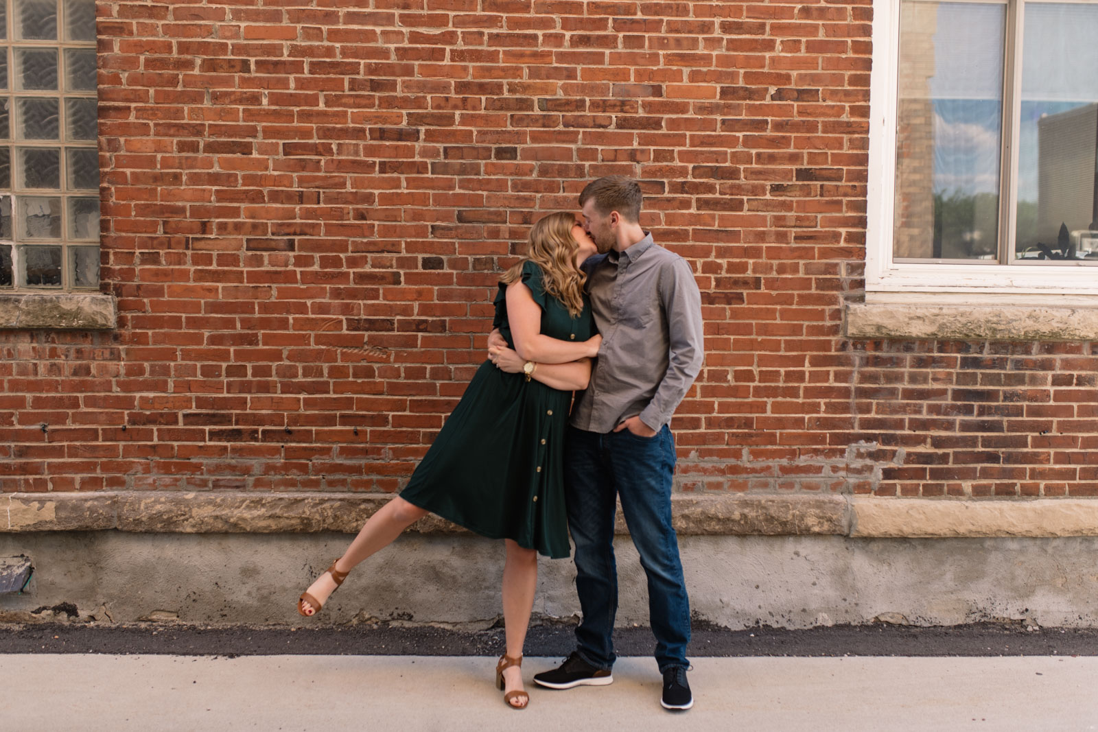 couple by brick wall cedar falls engagement