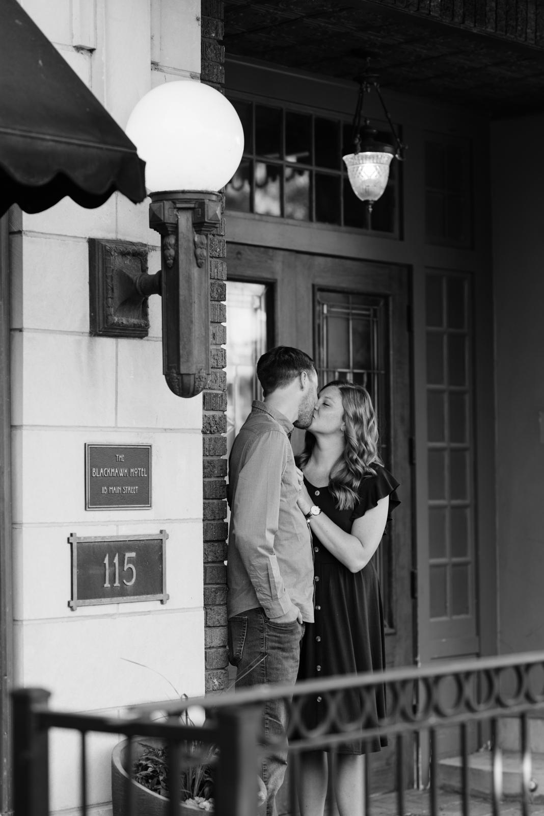 couple kissing outside cedar falls engagement session