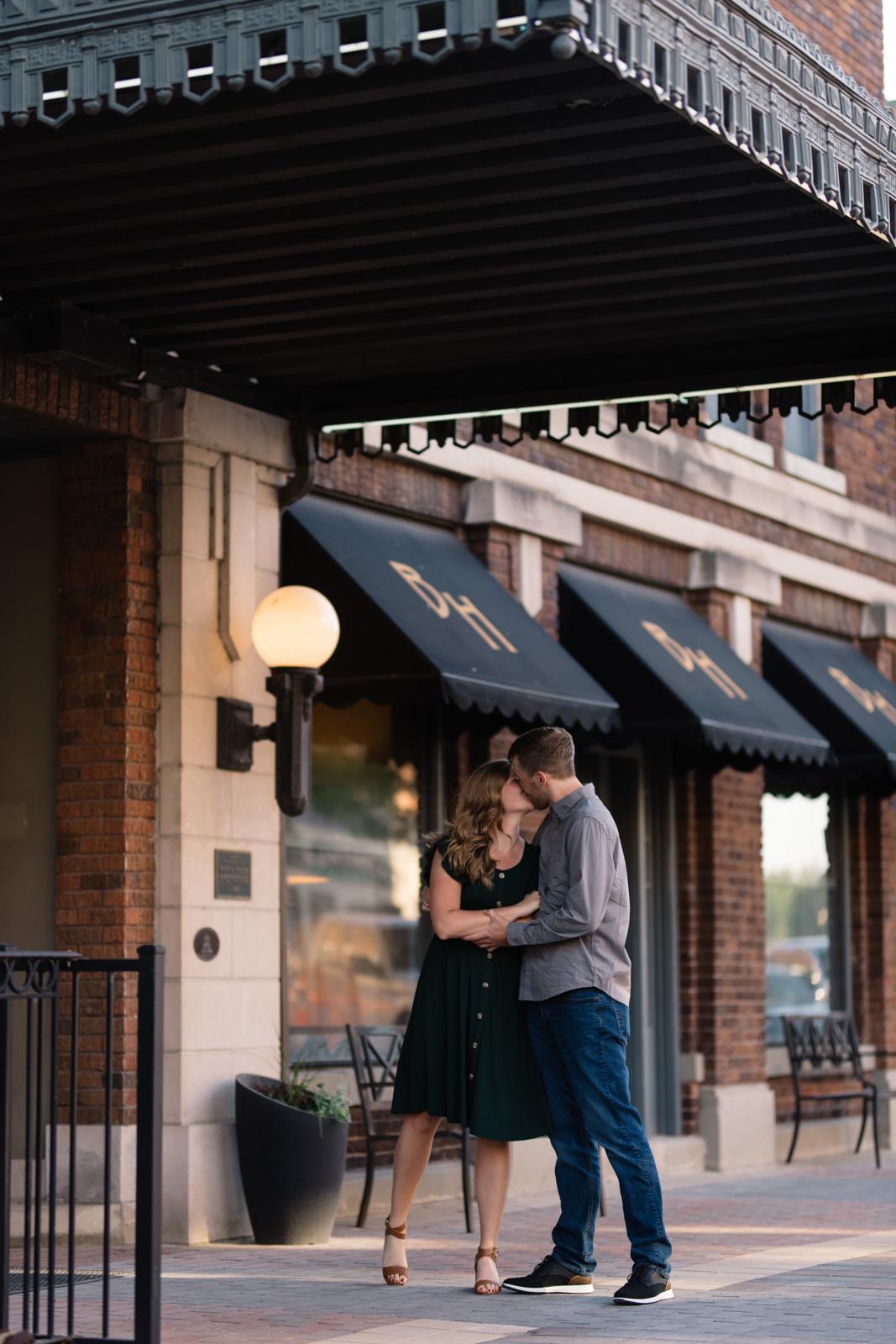 couple kissing engagement session main street cedar falls