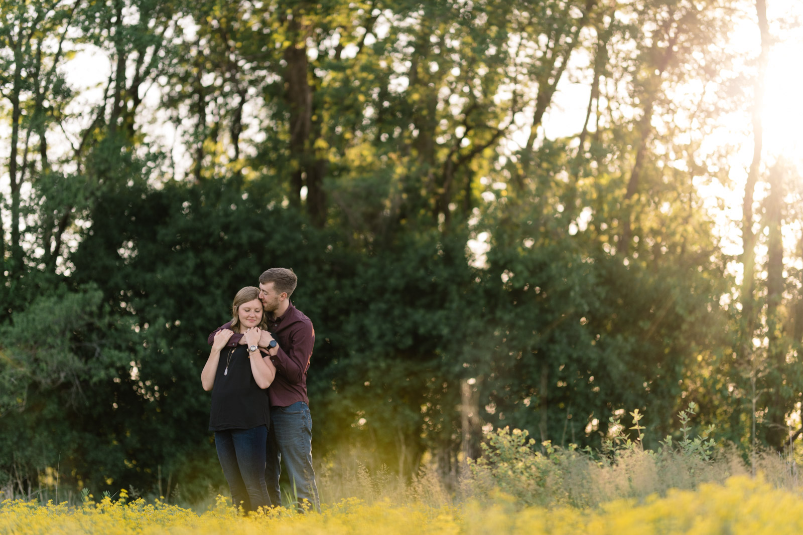 couple in field george wyth state park engagement