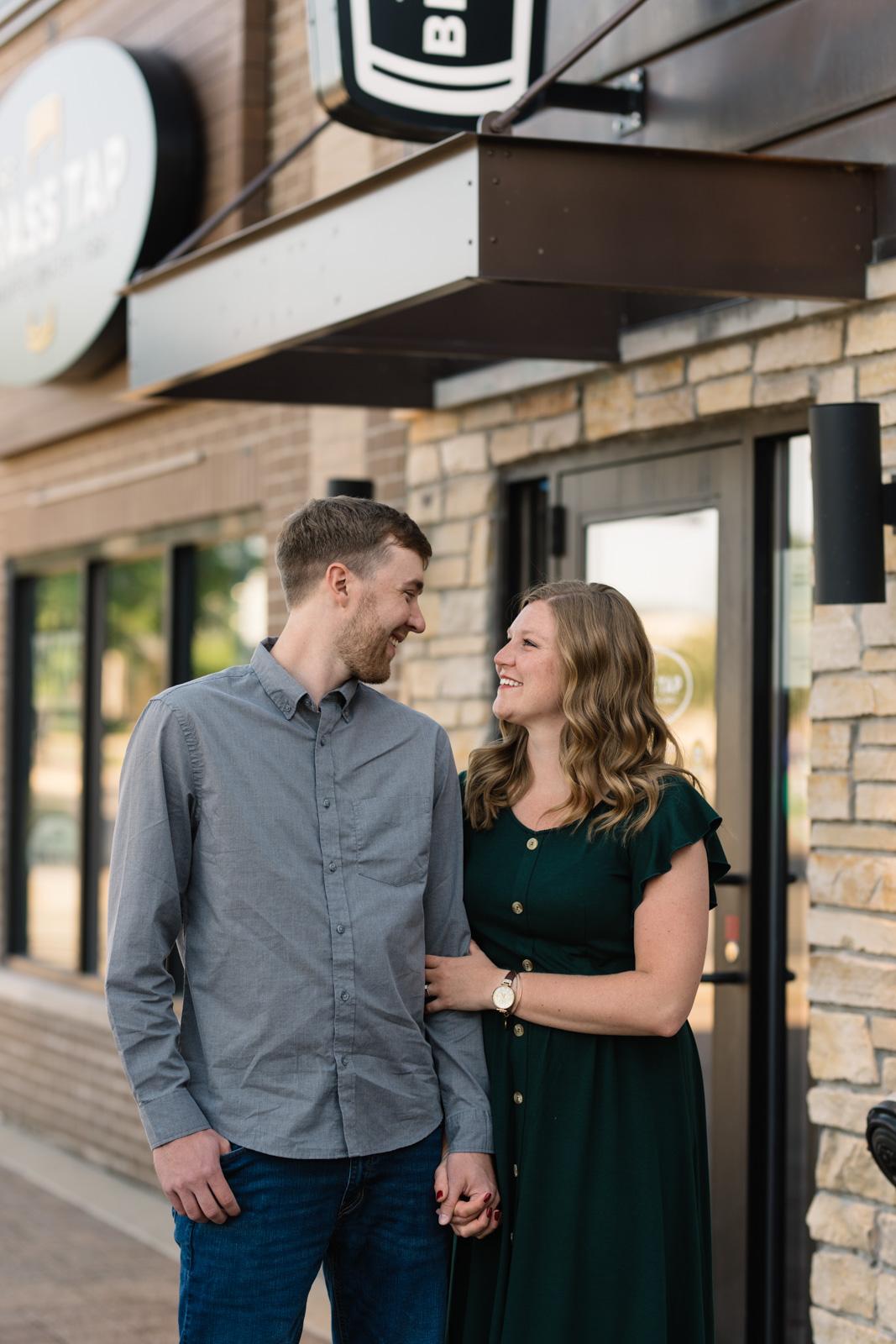 engaged couple on main street cedar falls