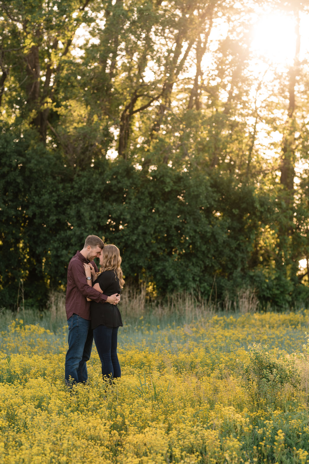 couple in field sunset george wyth state park engagement