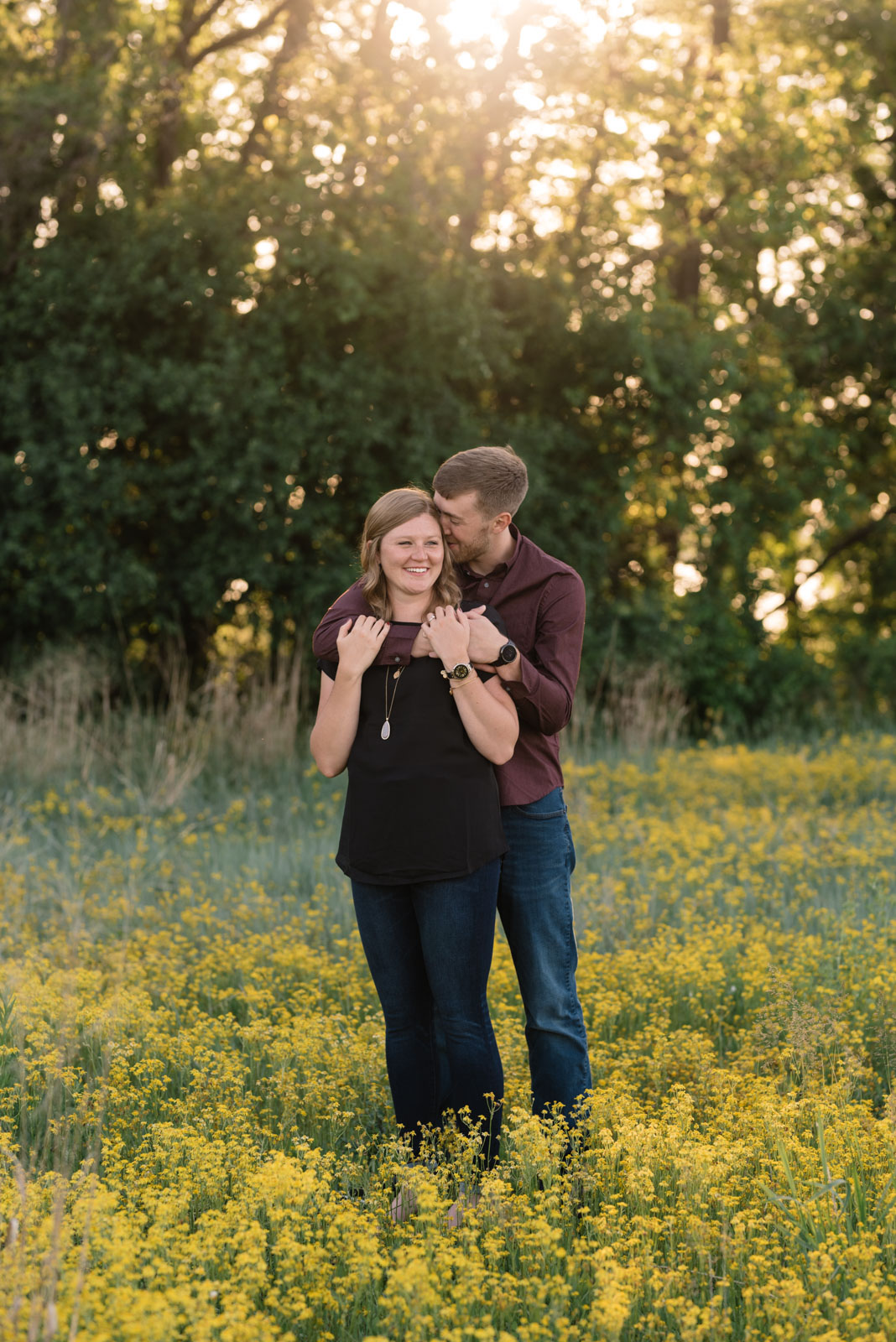 couple cuddling sunset cedar falls June engagement
