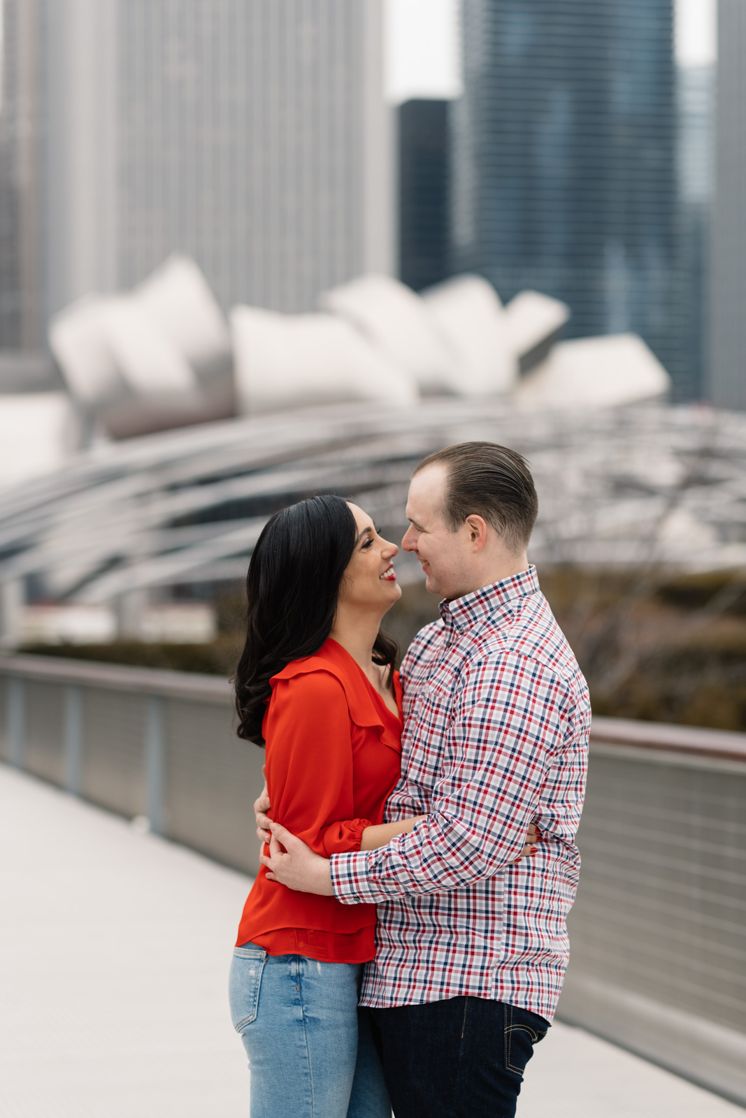 couple smiling downtown chicago engagement session