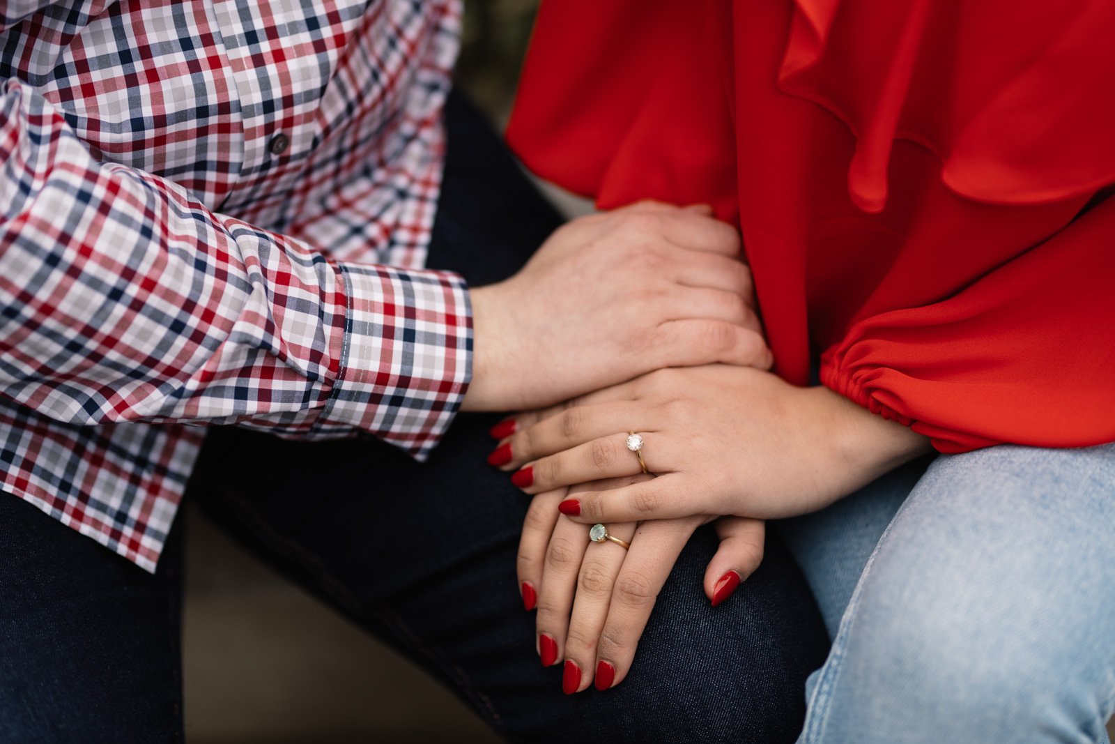 couple holding hands engagement ring