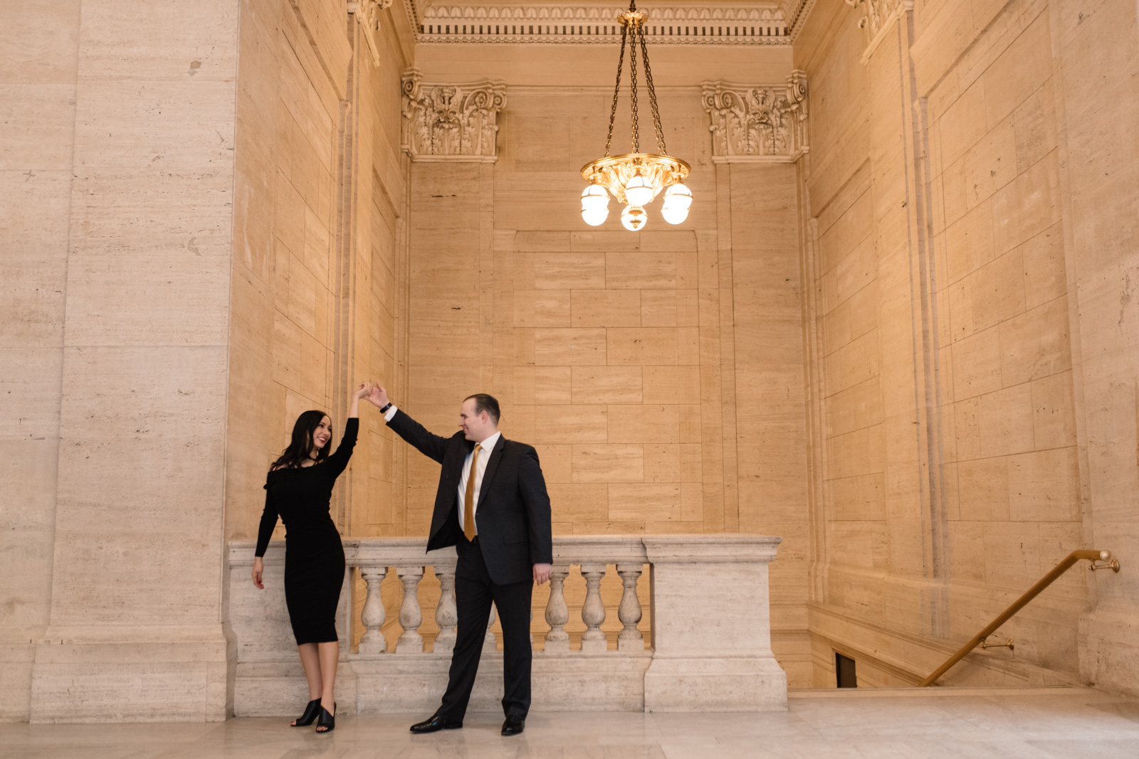 couple dancing at chicago union station engagement