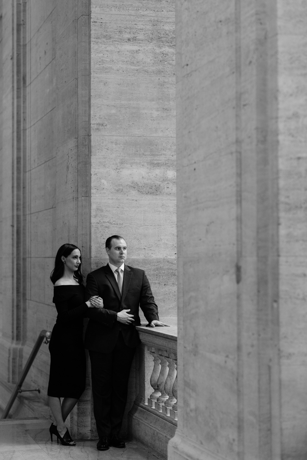 couple cuddling at chicago union station engagement session