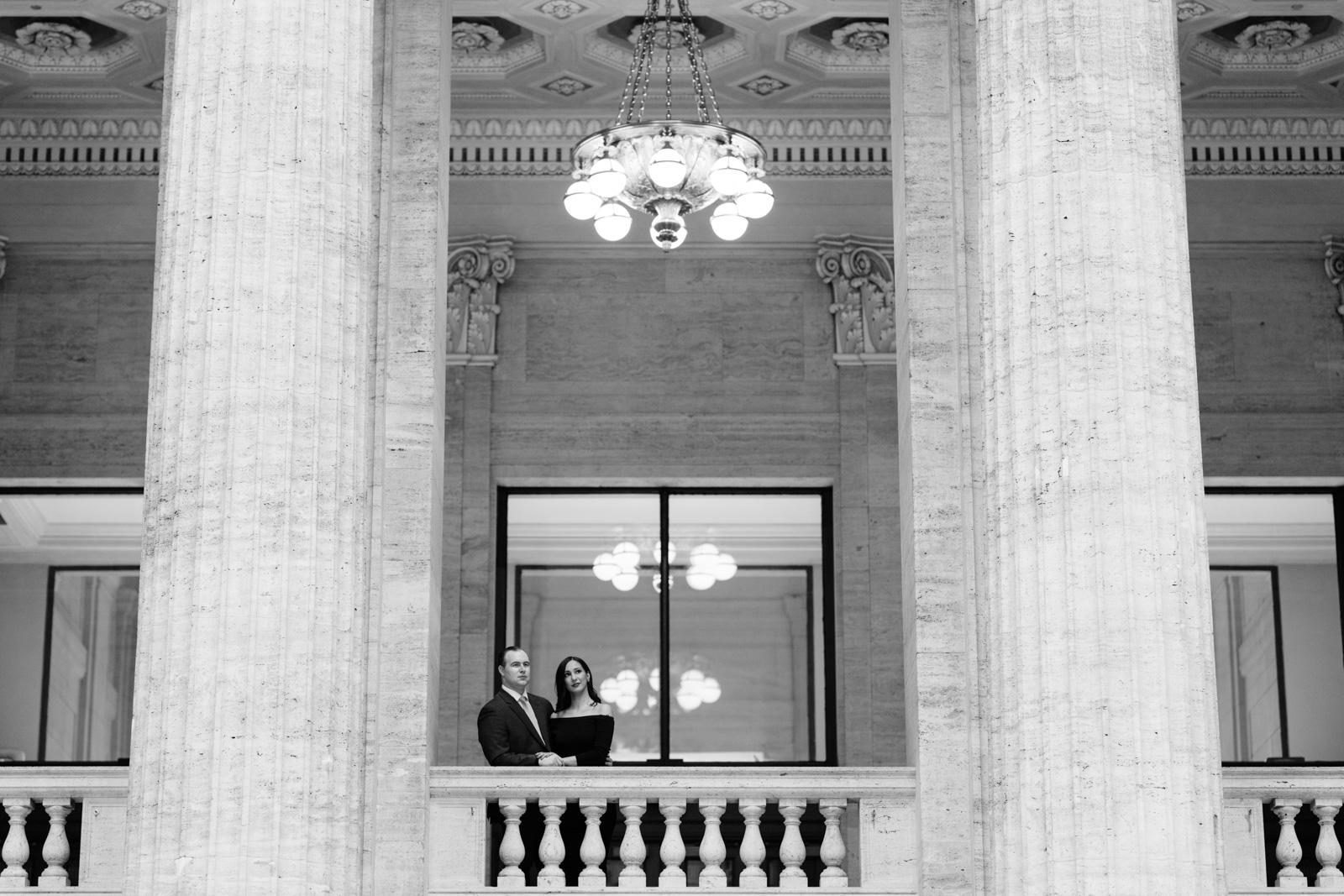 couple on balcony chicago union station engagement