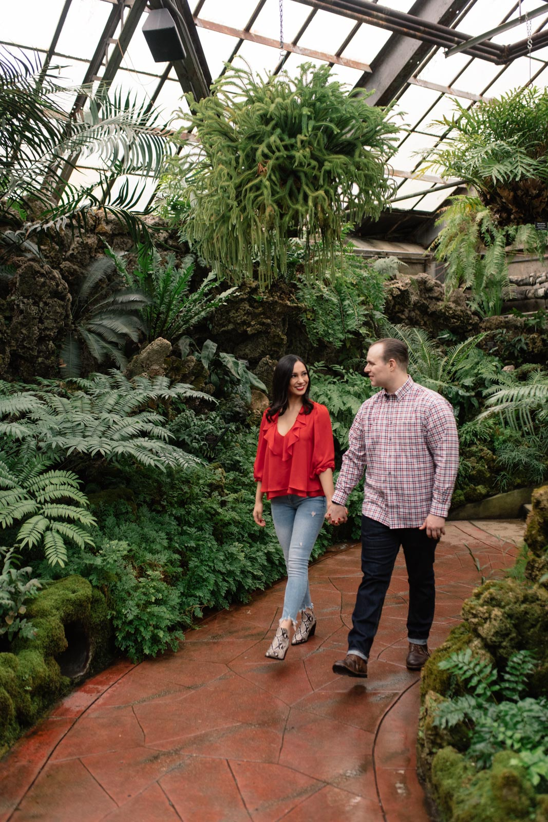 couple walking through lincoln park conservatory engagement session
