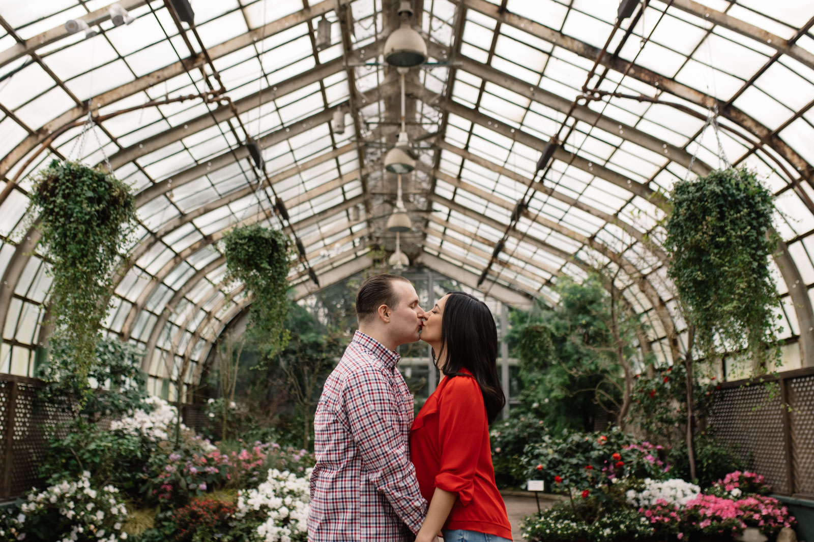 couple kissing in greenhouse lincoln park conservatory engagement session