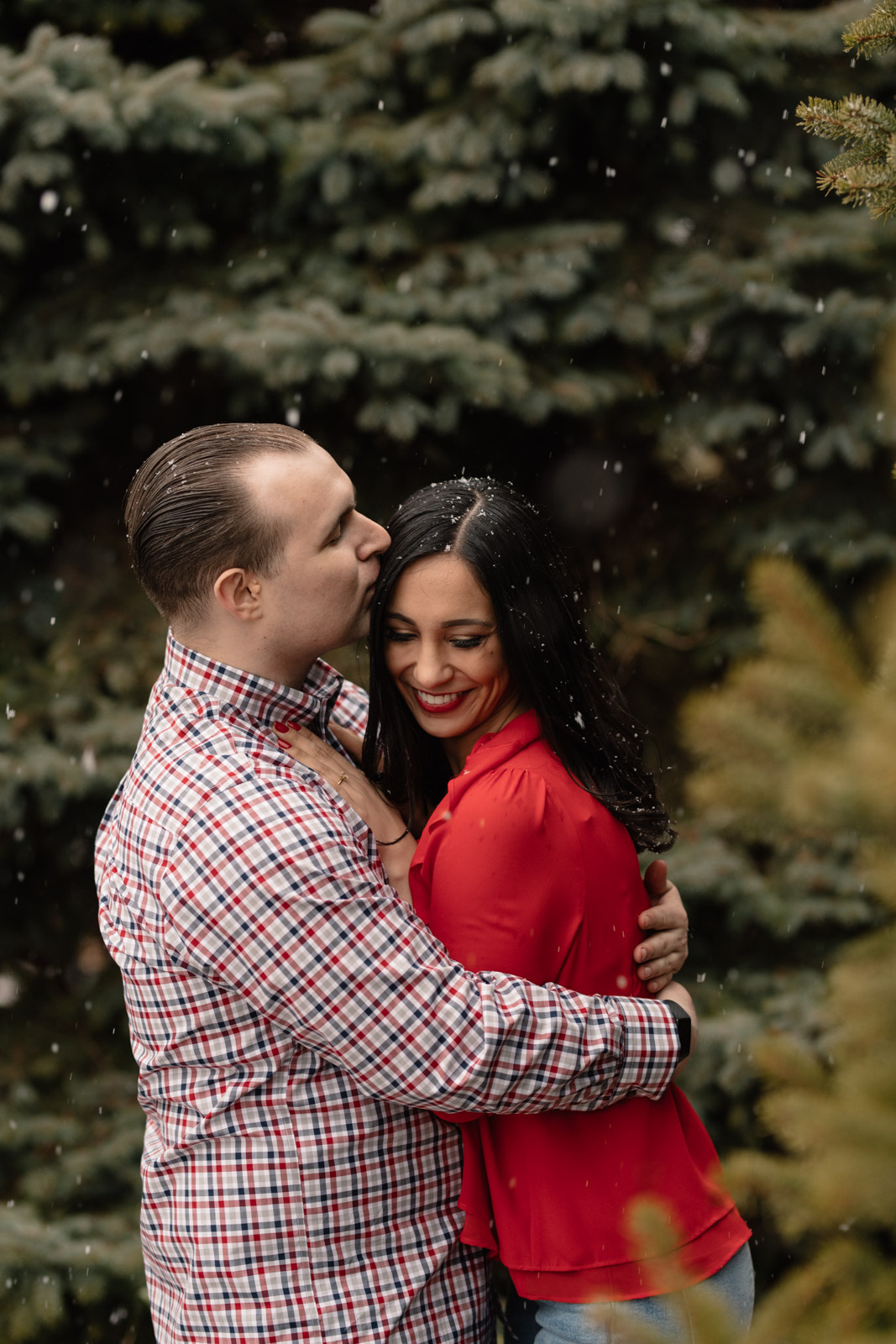 couple cuddling chicago winter engagement session