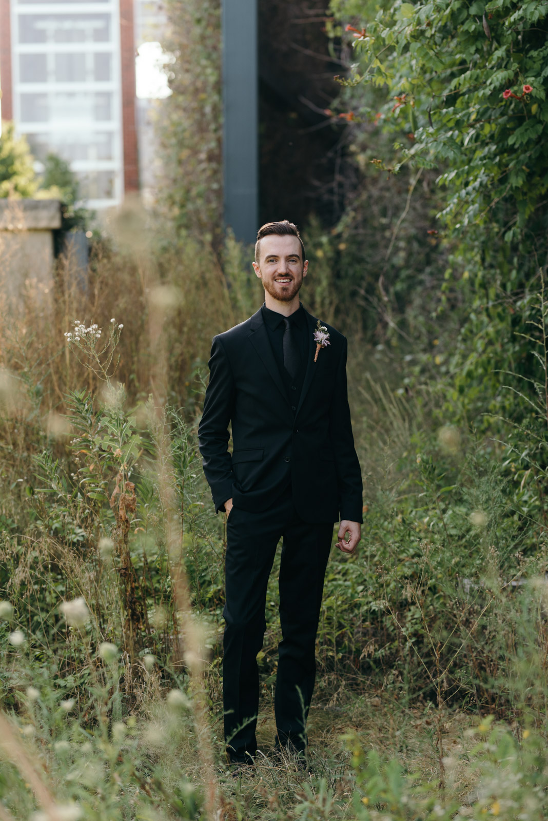 groom smiling outside Coralville wedding