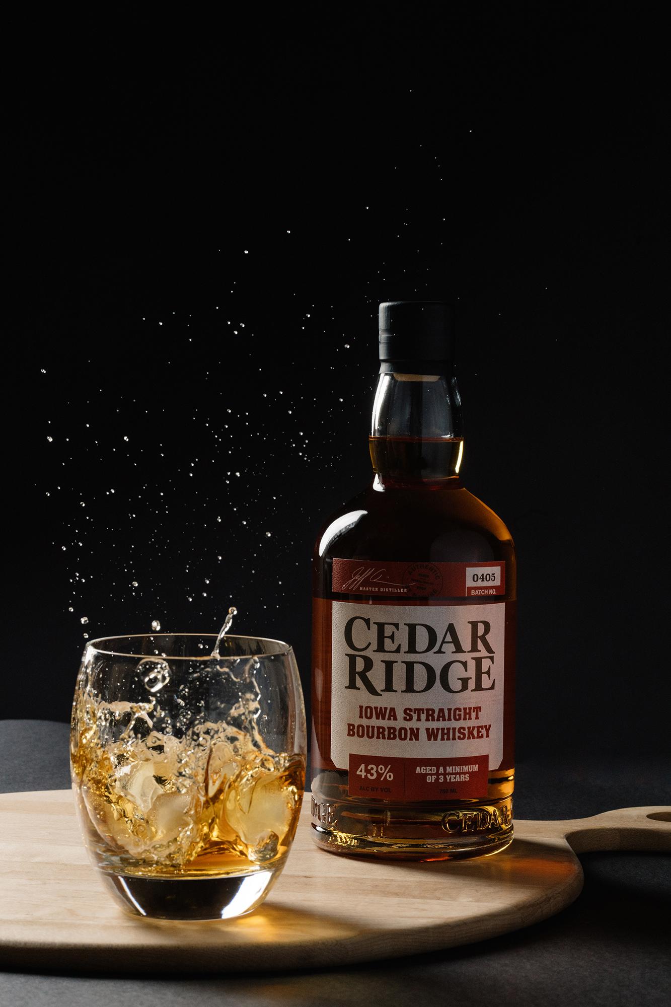 cedar ridge winery bourbon pouring into glass in the snow cedar rapids iowa