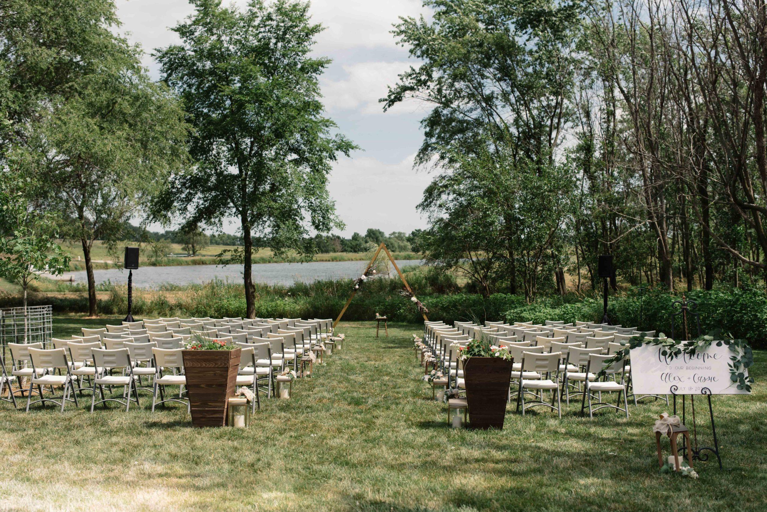 triangle wooden altar at outdoor Iowa barn wedding schafer century barn wedding venue