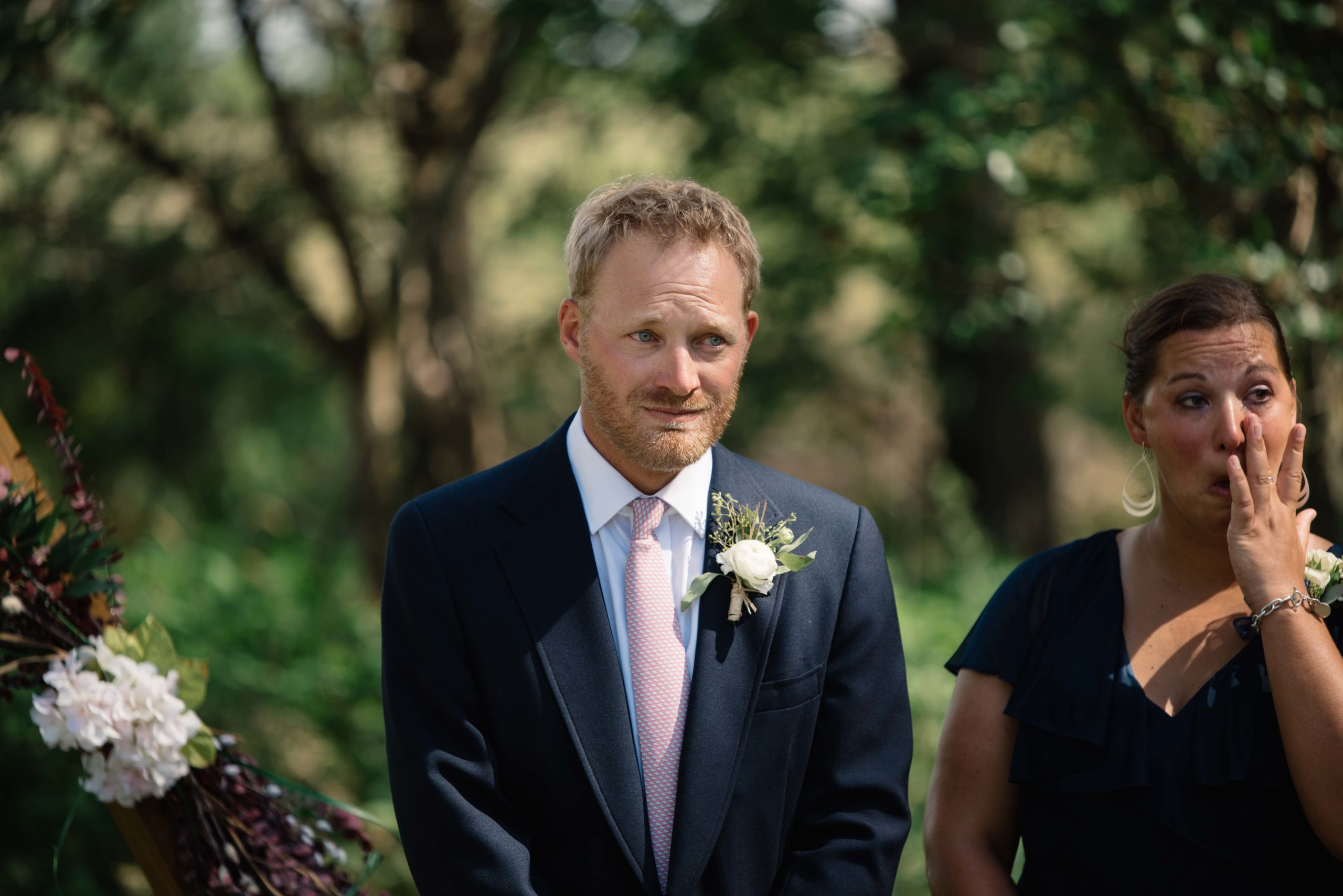 groom crying as he sees his bride for the first time outdoor Iowa wedding ceremony schafer century barn wedding venue