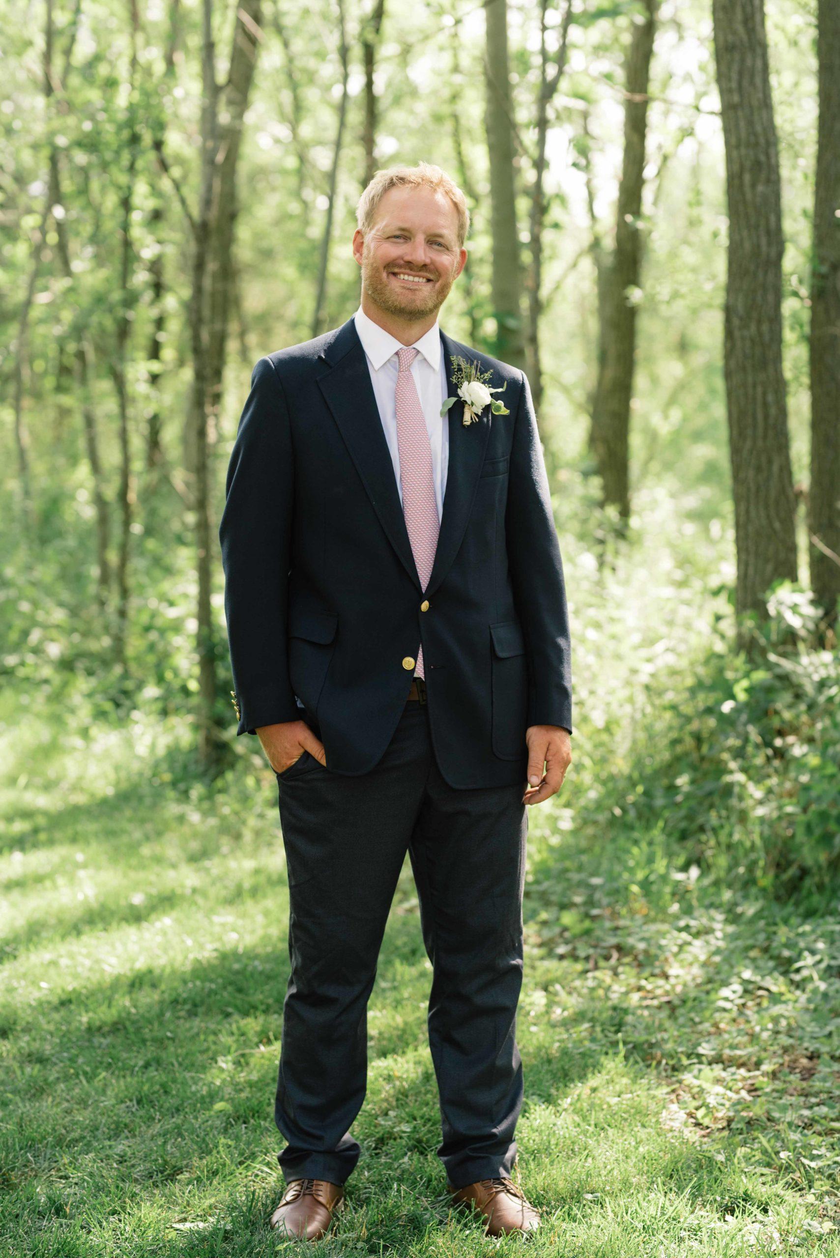 groom smiles for portrait schafer century barn wedding venue