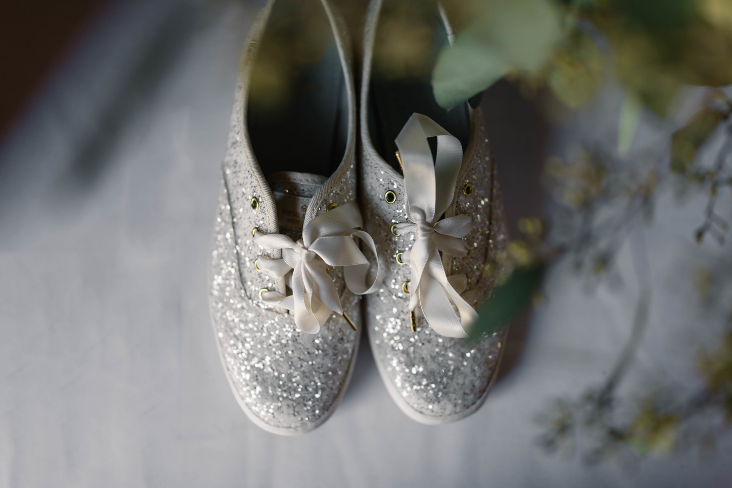 sparkle Kate Spade Keds wedding shoes with white rose weddin bouquet schafer century barn wedding venue