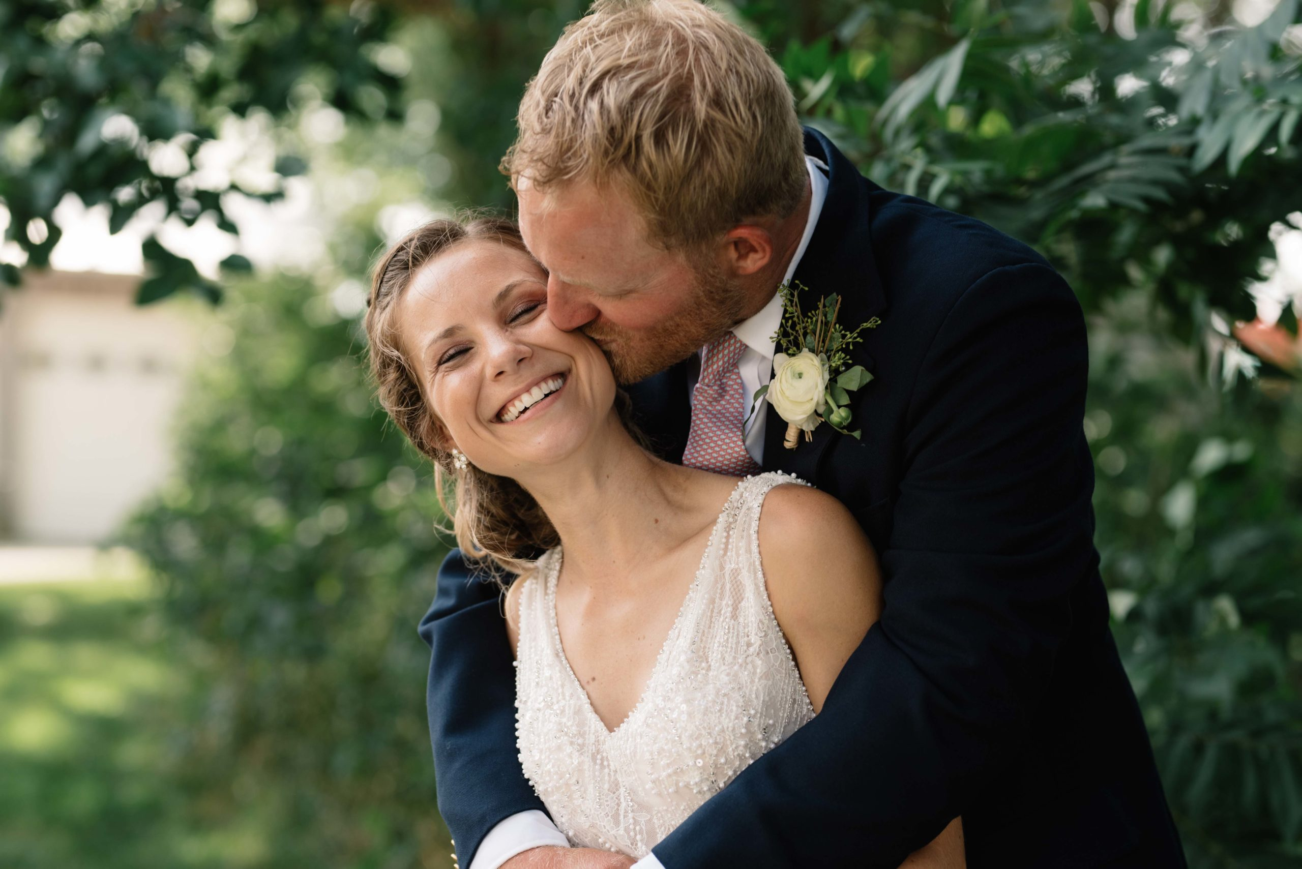 bride and groom hug by green tree schafer century barn wedding venue