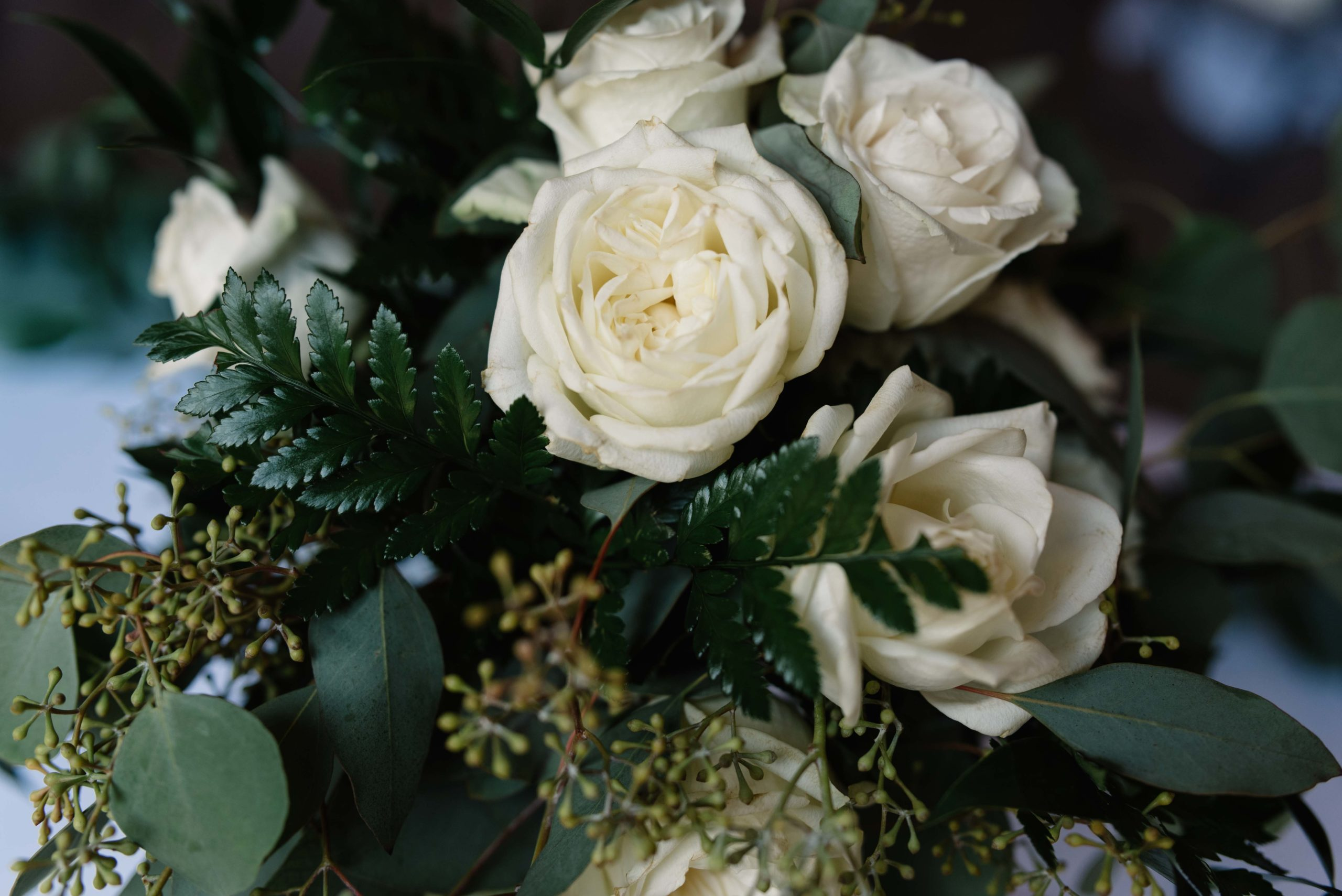 white rose and greenery floral bouquet schafer century barn wedding venue