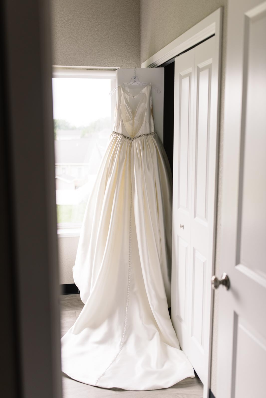 wedding dress hanging on door iowa wedding