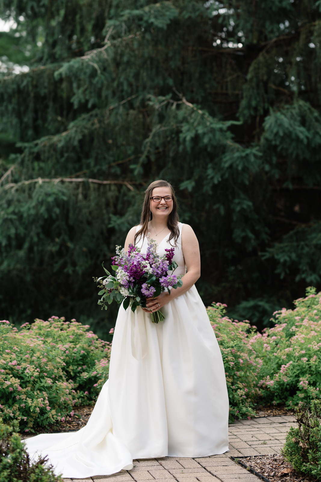 bride holding purple flower bouquet wartburg college wedding