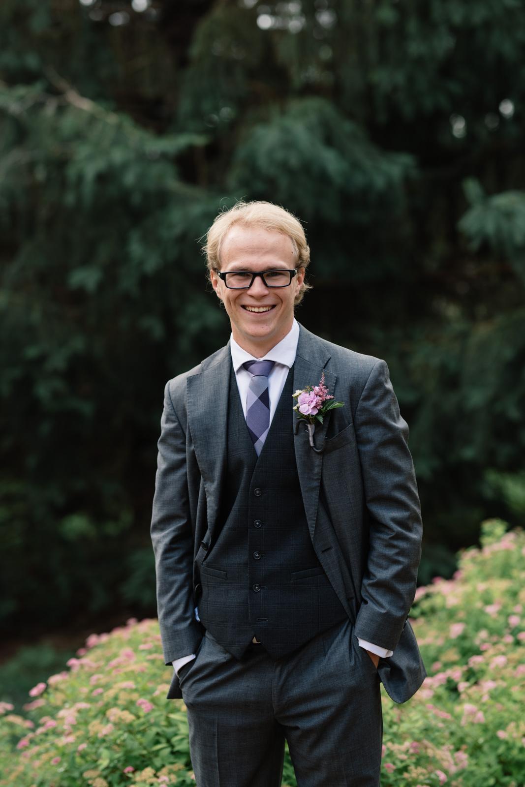 groom smiling waverly june wedding