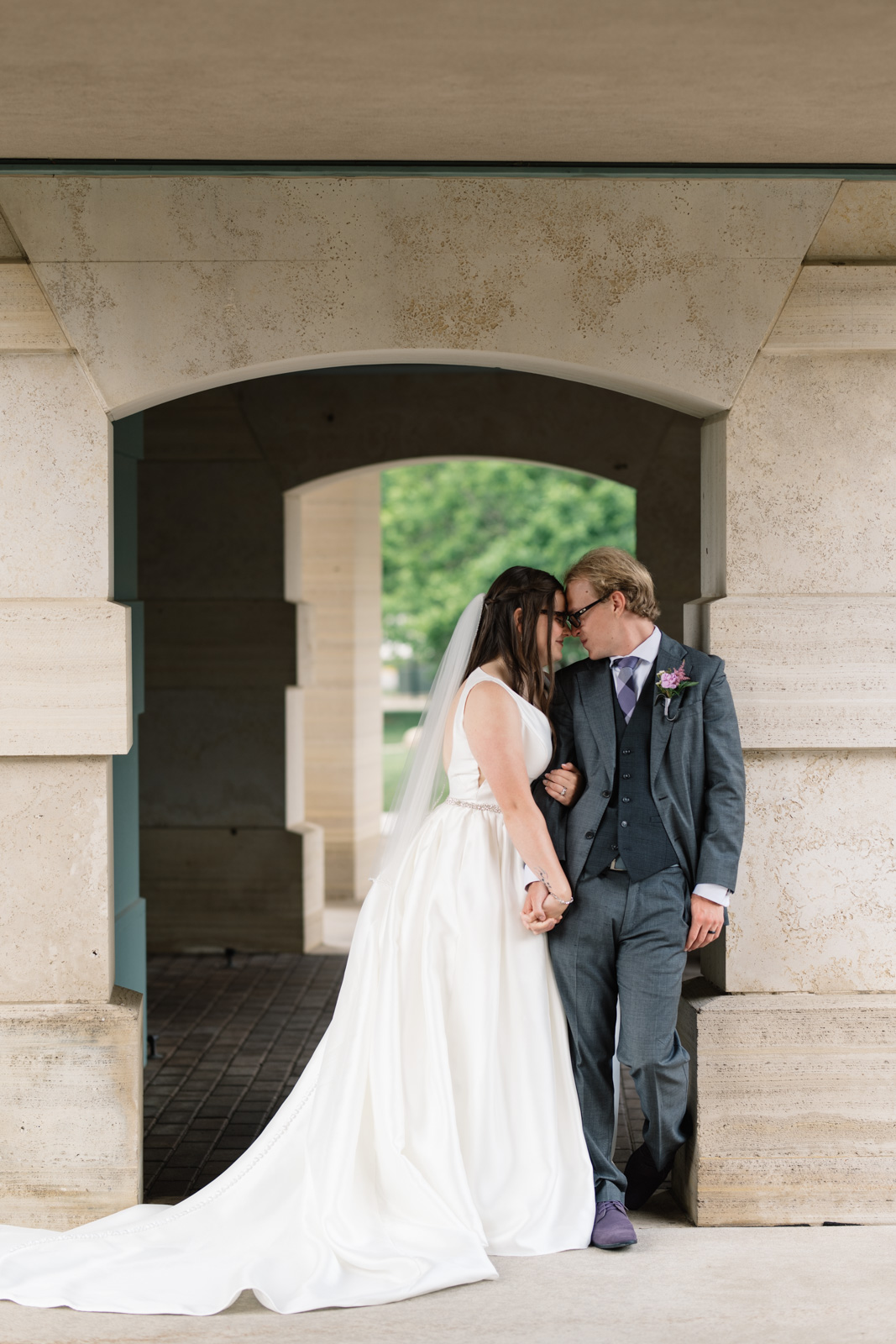 bride and groom holding hands outside wartburg college chapel