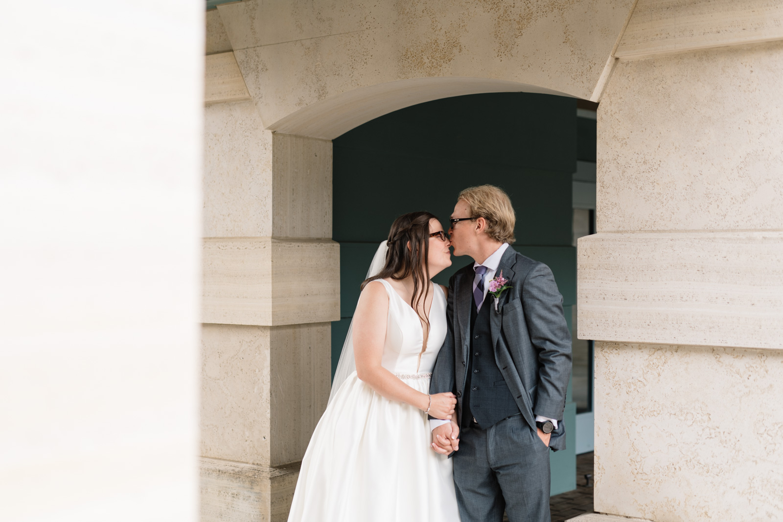 bride and groom kissing outside wartburg college chapel