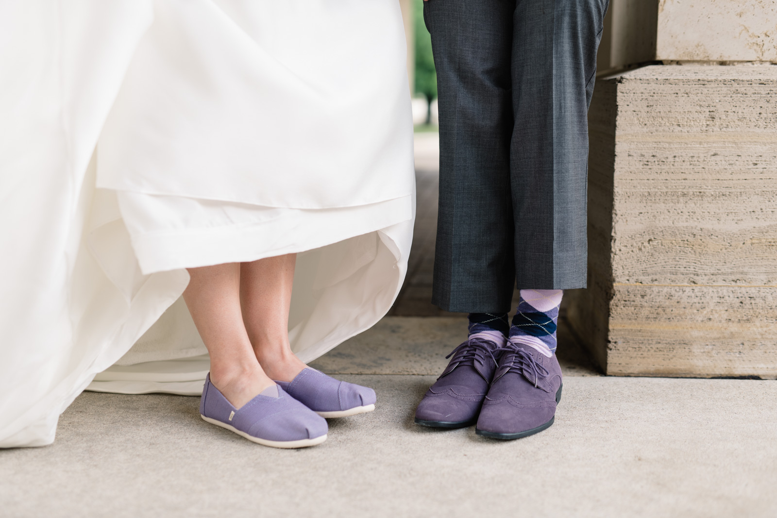 bride and groom purple shoes