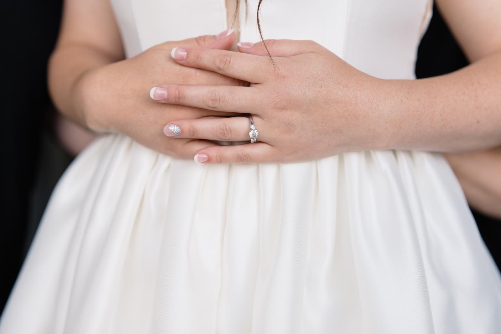 bride putting on wedding dress iowa wedding