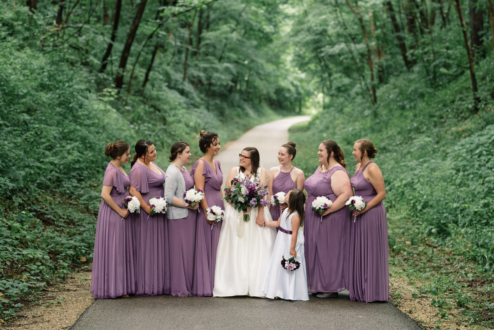 bride with bridesmaids iowa wedding