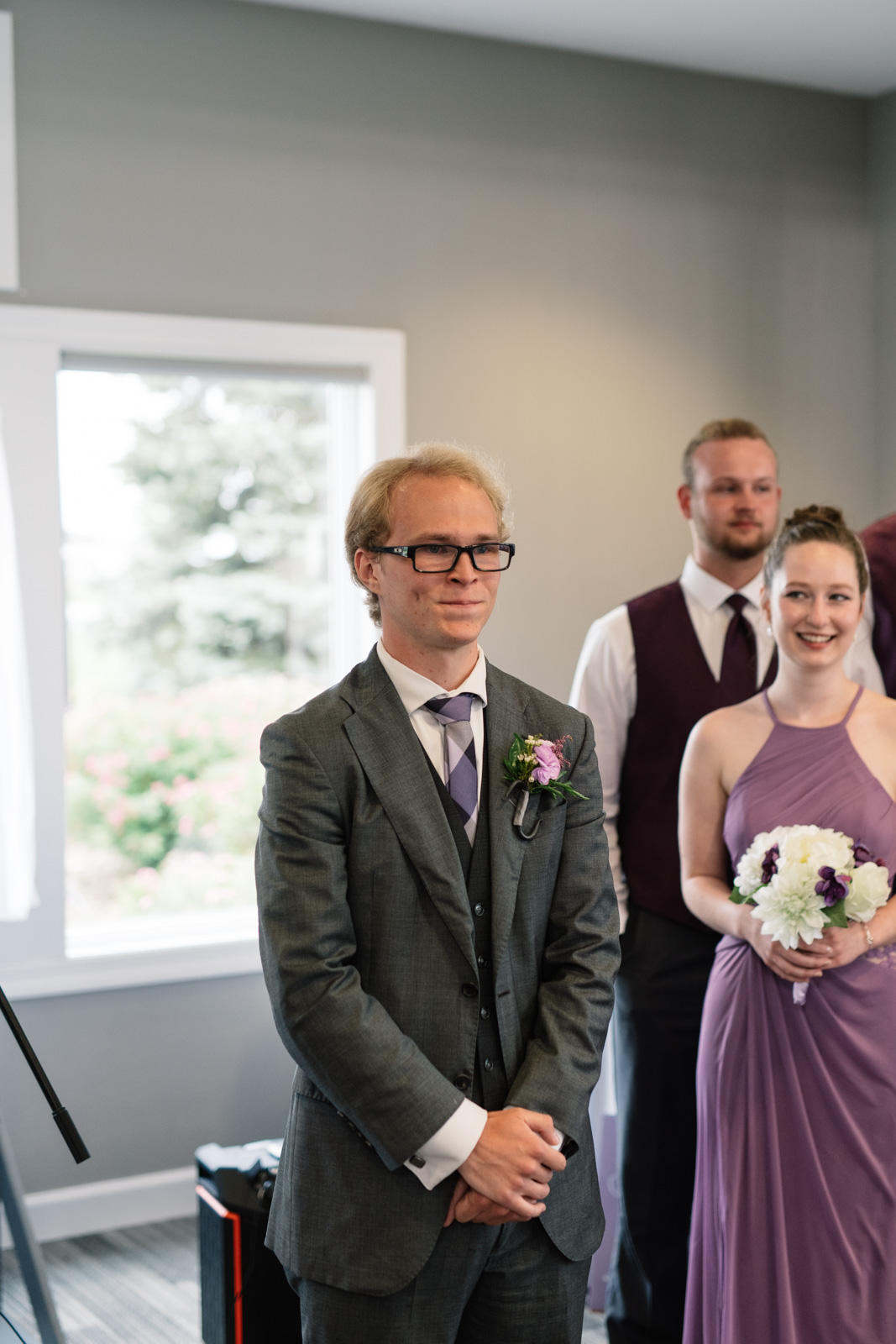 groom during wedding ceremony fox ridge wedding venue