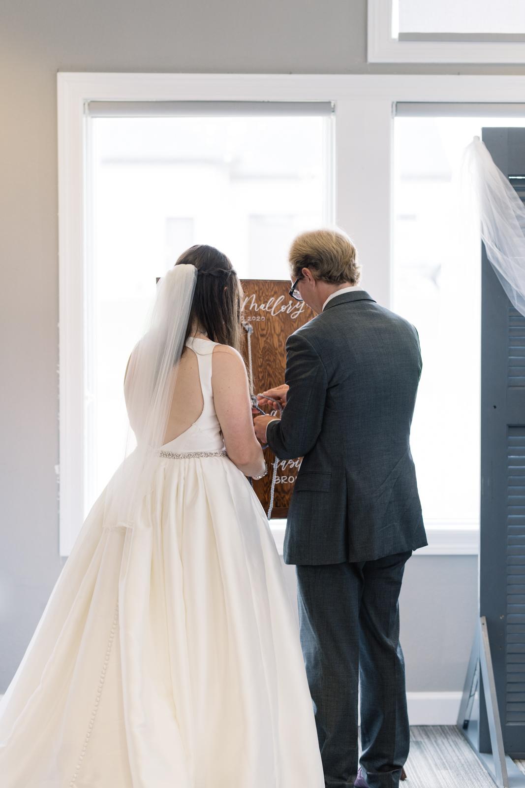 knot ceremony during wedding fox ridge golf course wedding