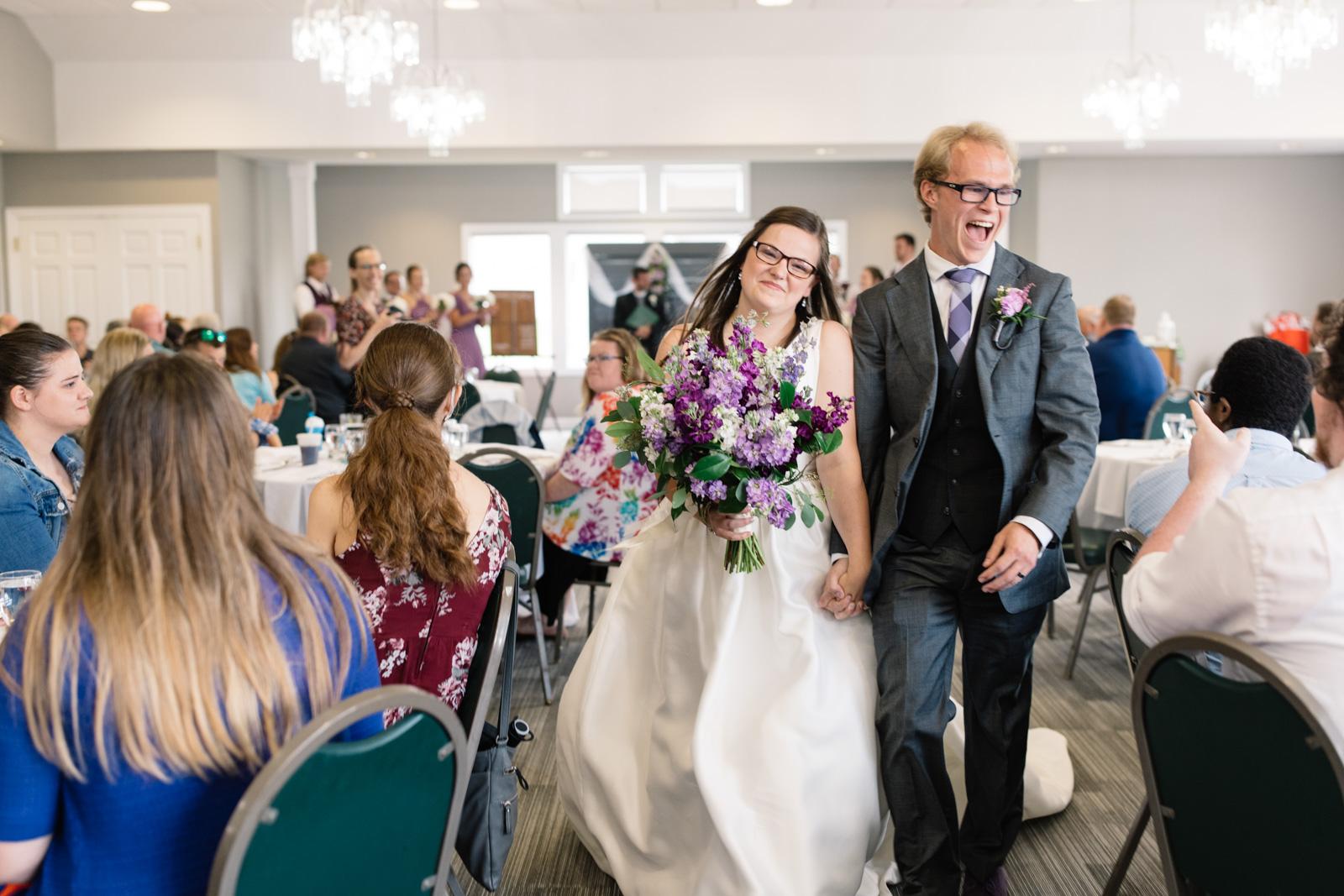 bride and groom walking down the aisle fox ridge golf course wedding venue
