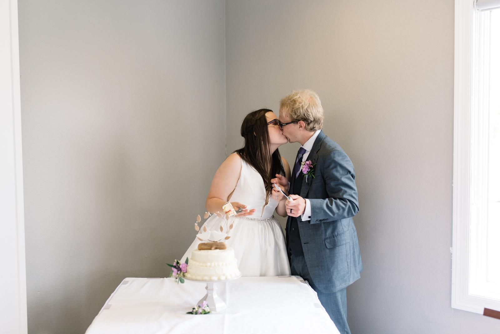 bride and groom kissing fox ridge golf wedding venue