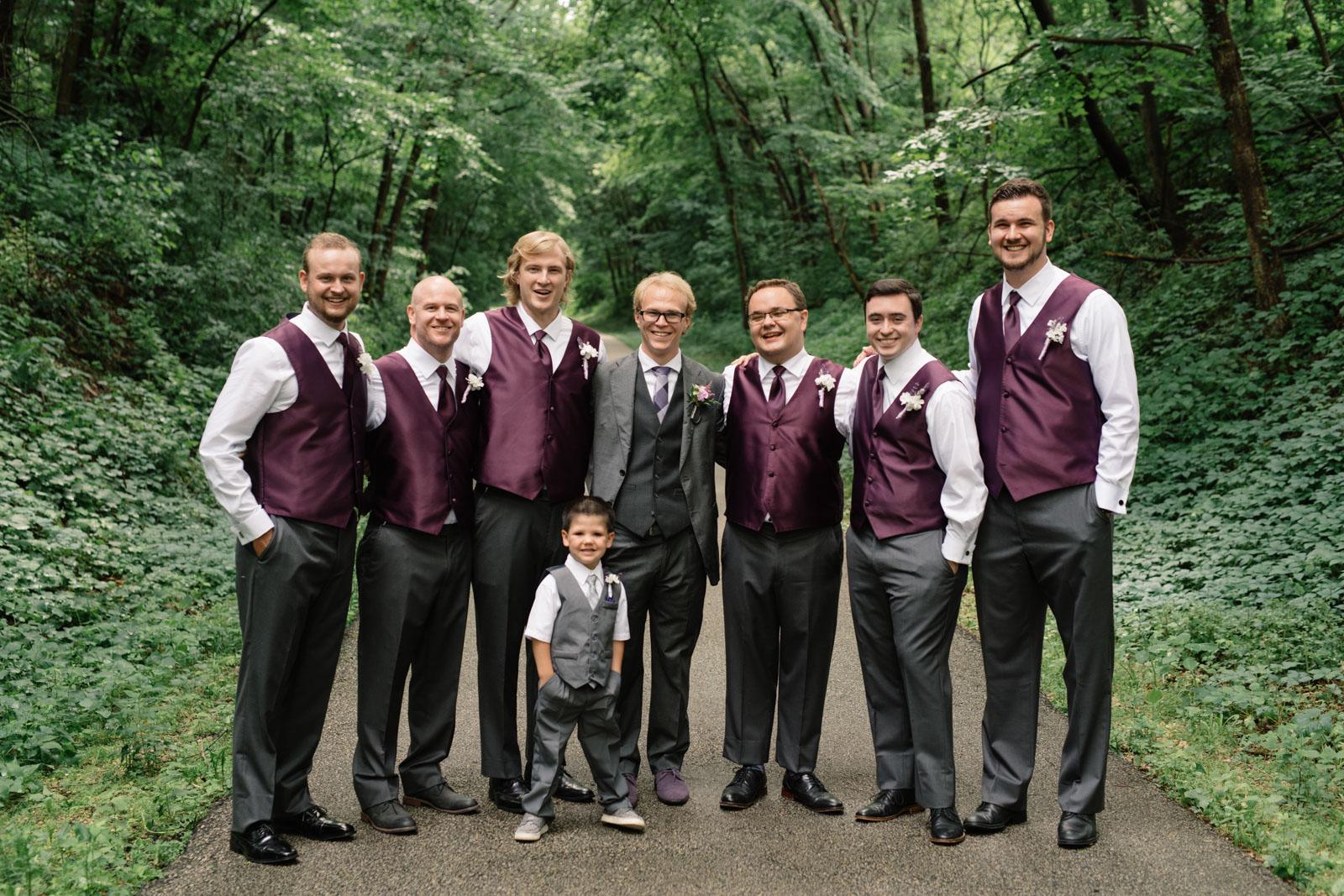 groom with groomsmen iowa june wedding