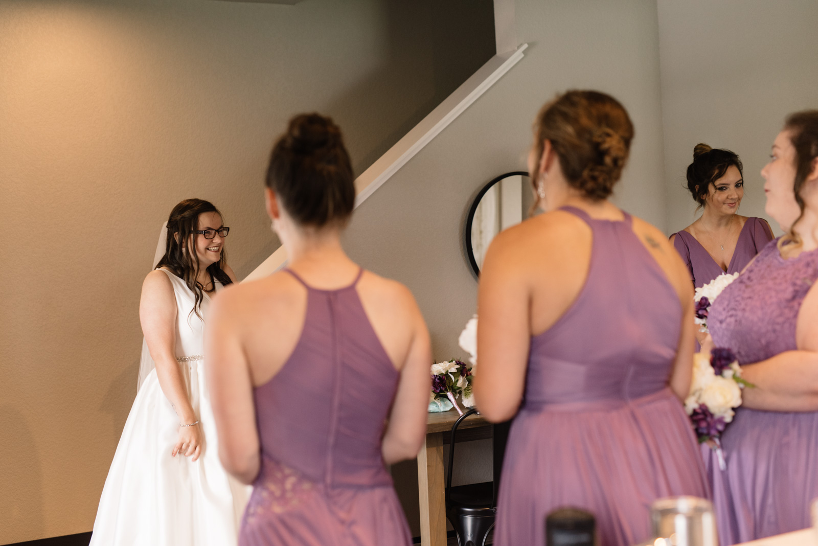 bride reaction first look with bridesmaids