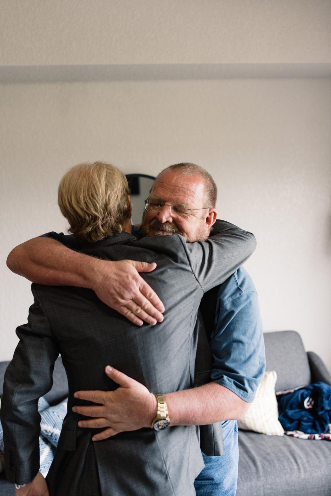 groom hugging dad iowa wedding