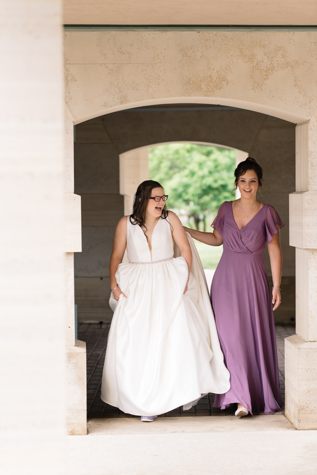 maid of honor walking with bride first look wartburg college wedding
