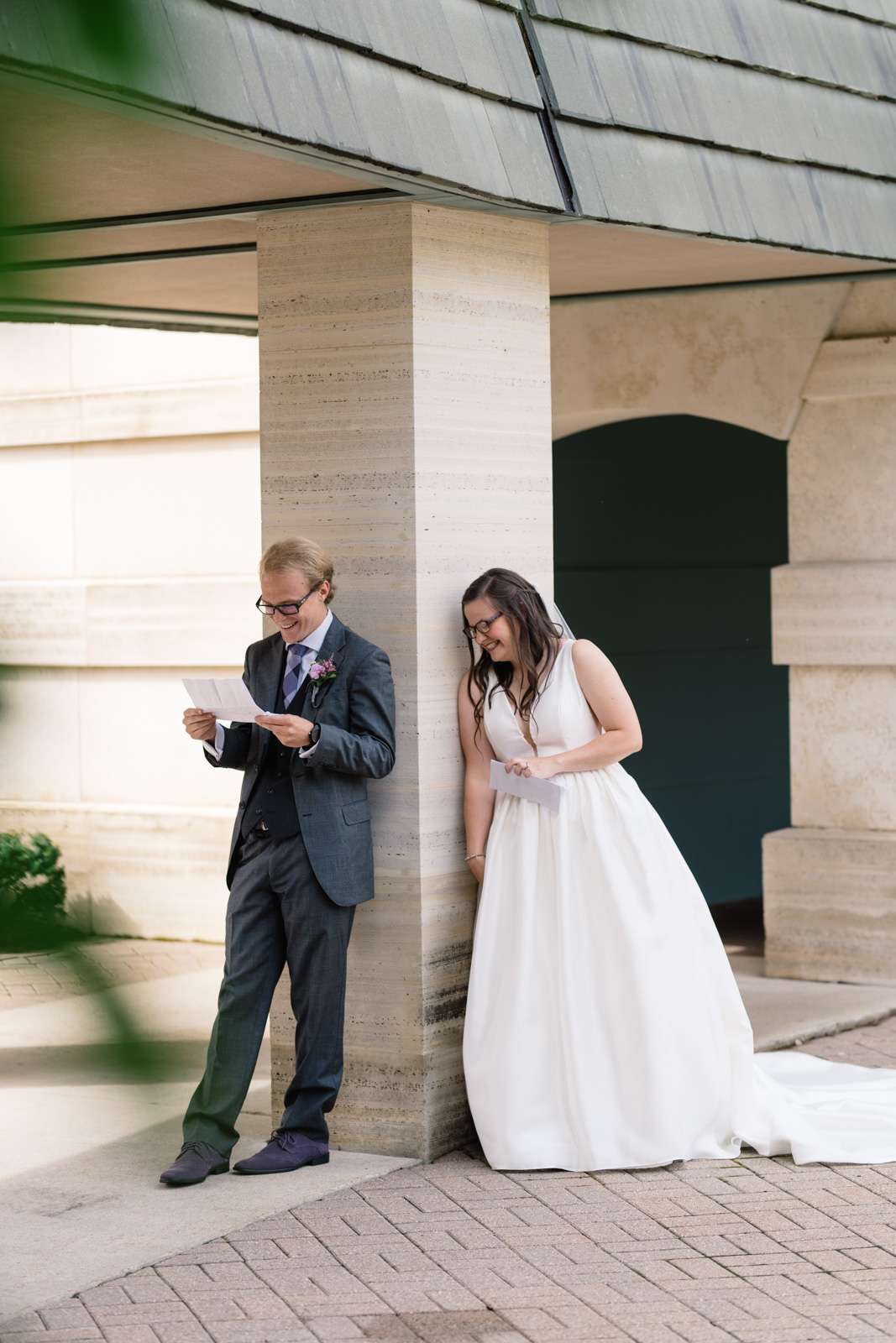 bride and groom reading letters wartburg college wedding