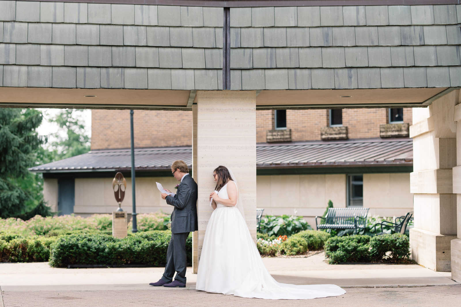 bride and groom read letters to each other wartburg college wedding