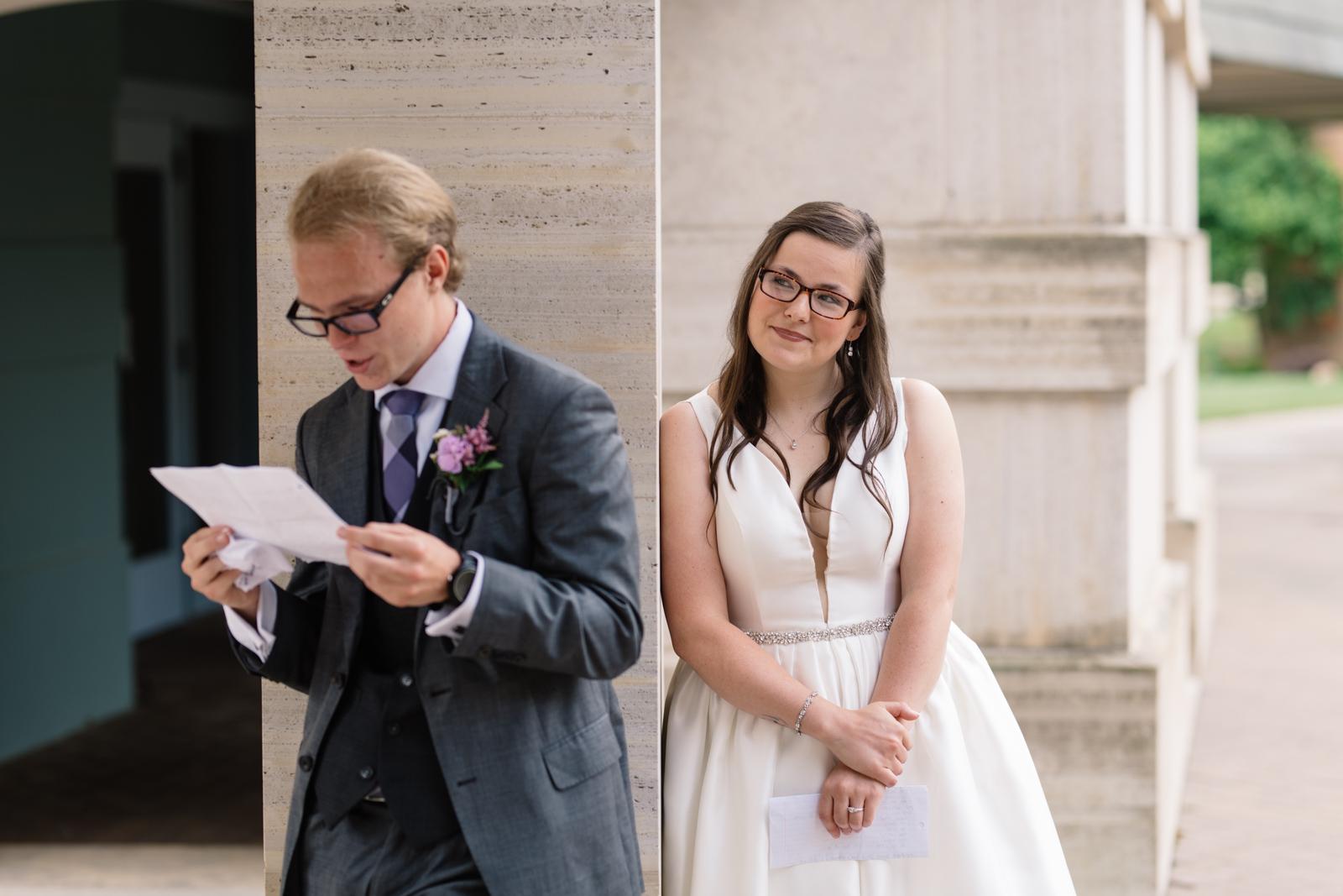 bride looking at groom reading letter wartburg college wedding