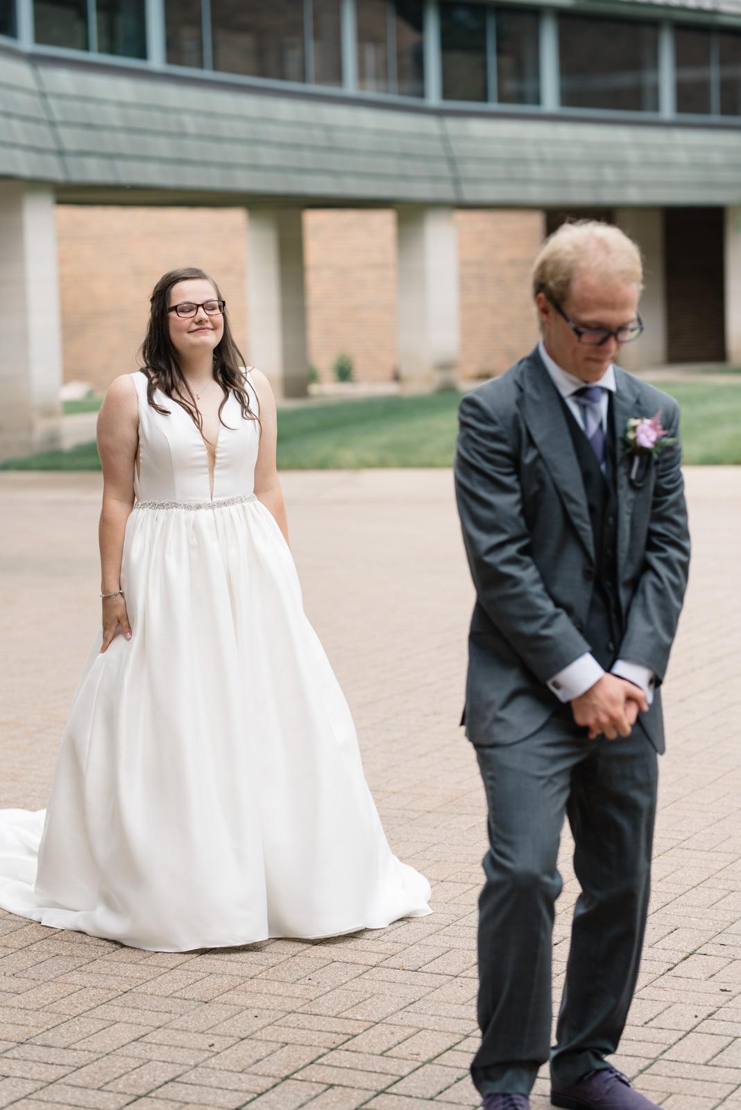bride and groom first look wartburg college wedding